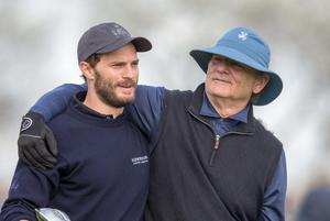 Actor and Comedian Bill Murray hugs 50 Shades of Grey actor Jamie Dornan as they walk of the 12th tee during round one of the Alfred Dunhill Links Championship at Carnoustie
