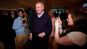 Sinn Fein candidate Martin McGuinness arrives at the Foyle Arena in Londonderry, as counting of votes continues in the the Foyle and East Londonderry constituencies in the Northern Ireland Assembly Elections. PA