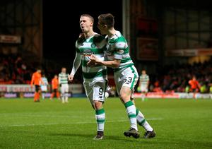 Celtic's Leigh Griffiths celebrates scoring his side's third goal of the game during the Ladbrokes Scottish Premiership match at Tannadice Park, Dundee.  Andrew Milligan/PA Wire.