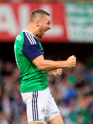 Northern Ireland's Conor Washington celebrates after scoring the team's second goal against Belarus during an international friendly football match between Northern Ireland and Belarus at Windsor Park in Belfast, Northern Ireland, on May 27, 2016. / AFP PHOTO / PAUL FAITHPAUL FAITH/AFP/Getty Images