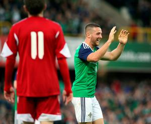 Northern Ireland's Conor Washington (R) celebrates after scoring the team's second goal against Belarus during an international friendly football match between Northern Ireland and Belarus at Windsor Park in Belfast, Northern Ireland, on May 27, 2016. / AFP PHOTO / PAUL FAITHPAUL FAITH/AFP/Getty Images