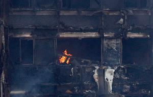 Flames and smoke engulf Grenfell Tower, a residential block of flats in west London on June 14, 2017, as firefighters continue to control a fire that started in the early hours of the morning.  Six people were confirmed dead in a massive fire that engulfed a London tower block before dawn on Wednesday and the number is expected to rise, police said.   / AFP PHOTO / Adrian DENNISADRIAN DENNIS/AFP/Getty Images