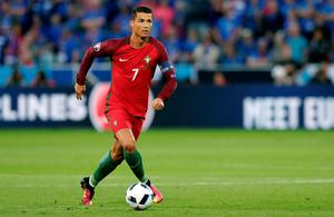 Portugal's Cristiano Ronaldo drives the ball during the Euro 2016 Group F soccer match between Portugal and Iceland at the Geoffroy Guichard stadium in Saint-Etienne, France, Tuesday, June 14, 2016. (AP Photo/Pavel Golovkin)