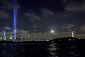 JERSEY CITY, NJ - SEPTEMBER 10: The World Trade Center Tribute in Lights and the Statue of Liberty are seen from Liberty State Park on September 10, 2014 in Jersey City New Jersey. Tomorrow marks the 13th anniversary of the 9/11 terrorist attacks that claimed the lives of 2,996 people in New York City, Washington, DC and a field in Shanksville, Pennsylvania.  (Photo by Kena Betancur/Getty Images)
