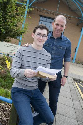 St. Joseph's Boys School, Derry student Gabrielius Dobrovolskis is congratulated on his A Level results by Senior Teacher Mr. Gerard Doherty at the school yesterday morning.