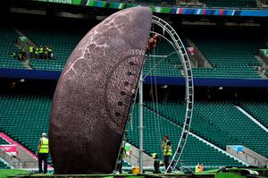 TOPSHOTS Workers set up the structure for a giant rugby ball on the pitch of the Twickenham Stadium, west London, on September 15, 2015, ahead of the 2015 Rugby Union World Cup. Twickenham Stadium will host the Rugby Union World Cup's opening match between England and Fiji on September 18, 2015.  AFP PHOTO / GABRIEL BOUYSGABRIEL BOUYS/AFP/Getty Images