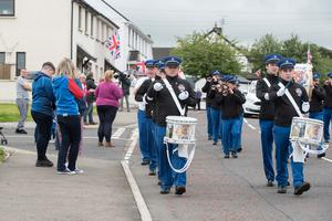 Members of the East Bank Protestant Boys Flute Band make their way through Irish Street in Londonderry on Monday as they marked the Twelfth of July. Picture Martin McKeown. 13.07.20