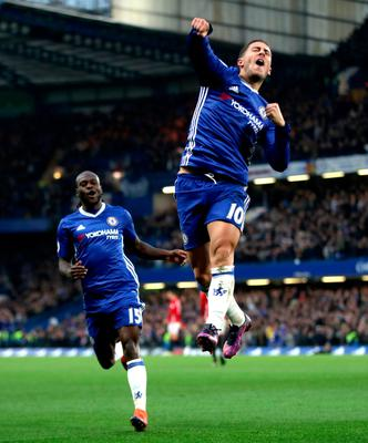 "Chelsea's Eden Hazard celebrate scoring his side's third goal of the game during the Premier League match at Stamford Bridge, London. PRESS ASSOCIATION Photo. Picture date: Sunday October 23, 2016. See PA story SOCCER Chelsea. Photo credit should read: Nick Potts/PA Wire. RESTRICTIONS: EDITORIAL USE ONLY No use with unauthorised audio, video, data, fixture lists, club/league logos or ""live"" services. Online in-match use limited to 75 images, no video emulation. No use in betting, games or single club/league/player publications."