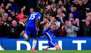 "Chelsea's Eden Hazard celebrates scoring his side's third goal of the game during the Premier League match at Stamford Bridge, London. PRESS ASSOCIATION Photo. Picture date: Sunday October 23, 2016. See PA story SOCCER Chelsea. Photo credit should read: John Walton/PA Wire. RESTRICTIONS: EDITORIAL USE ONLY No use with unauthorised audio, video, data, fixture lists, club/league logos or ""live"" services. Online in-match use limited to 75 images, no video emulation. No use in betting, games or single club/league/player publications."