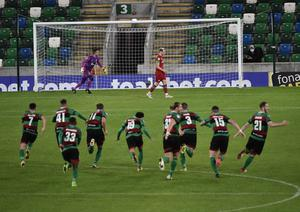 The moment Glentoran's Irish Cup semi-final victory was sealed as goalkeeper Elliott Morris saved the crucial penalty.