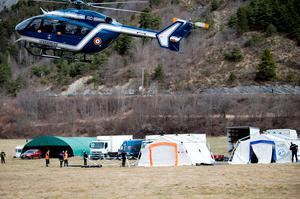 Search and rescue teams attend to the crash site of the Germanwings Airbus in the French Alps on March 25, 2015 near Seyne, France.