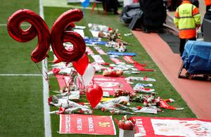 Flowers and balloons at the side of the pitch during the last memorial service to be held at Anfield, Liverpool, to mark 27 years to the day since the tragedy claimed 96 lives. PRESS ASSOCIATION Photo. Picture date: Friday April 15, 2016. The 96 Liverpool fans died in the crush on the Leppings Lane terraces at Sheffield Wednesday's Hillsborough stadium after going to see their team play Nottingham Forest in an FA Cup semi-final on April 15, 1989. See PA story MEMORIAL Hillsborough. Photo credit should read: Peter Byrne/PA Wire
