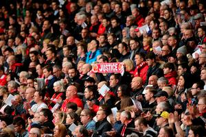 LIVERPOOL, ENGLAND - APRIL 15:  Liverpool FC supporters clap during a memorial service to mark the 27th anniversary of the Hillsborough disaster, at Anfield stadium on April 15, 2016 in Liverpool, England. Thousands of fans, friends and relatives took part in the final Anfield memorial service for the 96 victims of the Hillsborough disaster. Earlier this year relatives of the victims agreed that this year's service would be the last. Bells across the City of Liverpool rang out during a one minute silence in memory of the 96 Liverpool supporters who lost their lives during a crush at an FA Cup semi-final match against Nottingham Forest at the Hillsborough football ground in Sheffield, South Yorkshire in 1989.  (Photo by Christopher Furlong/Getty Images)