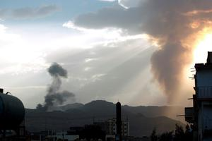 Smoke and flames rise allegedly from Shiite Huthi rebels camps located on Faj Attan Hill (L) and Aser mountain (R) following an airstrike by the Saudi-led alliance on April 6, 2015 in the Yemeni capital Sanaa. AFP/Getty Images