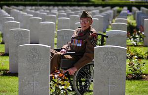 UKPEG PHOTO ESSAY PHOTOGRAPHER OF THE YEAR FINALIST  Normandy veteran, Ken Scott, 98, who was an infantry sergeant with the Durham Light Infantry on Gold Beach on D-Day, looks at headstones at Bayeux Cemetery following a service on the 70th anniversary of D-Day. Picture: Matt Cardy/Getty Images
