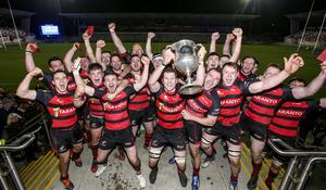 Cup kings: City of Armagh captain Robert Whitten leads the celebrations after winning the Bank of Ireland Ulster Senior Cup at Kingspan Stadium last night