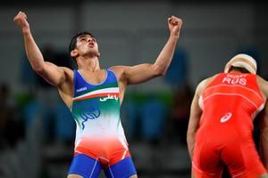 RIO DE JANEIRO, BRAZIL - AUGUST 19:  Hassan Aliazam Yazdanicharati of the Islamic Republic of Iran celebrates after defeating Aniuar Geduev of Russia during the Men's 74kg Gold Medal Wrestling match on Day 14 of the Rio 2016 Olympic Games at Carioca Arena 2 on August 19, 2016 in Rio de Janeiro, Brazil.  (Photo by Matthias Hangst/Getty Images) *** BESTPIX ***