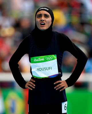 RIO DE JANEIRO, BRAZIL - AUGUST 12:  Kamia Yousufi of Afghanistan reacts after the competes in the Women's 100 metres preliminary on Day 7 of the Rio 2016 Olympic Games at the Olympic Stadium on August 12, 2016 in Rio de Janeiro, Brazil.  (Photo by Shaun Botterill/Getty Images)