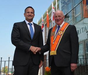 Pacemaker Press 8/6/2018 Taoiseach Leo Varadkar  is greeted by Grand Master of the Orange Order Edward Stevenson as he visits the Museum of Orange Heritage in Belfast. It will be the first time an Irish prime minister has been to the headquarters of the Orange Order in Belfast.  Pic Colm Lenaghan /Pacemaker