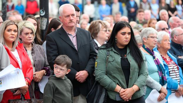 People gathered on Market Street, Omagh, during the ceremony to mark the 20th anniversary of the Omagh bombing on 15 August 1998. PRESS ASSOCIATION Photo. Picture date: Wednesday August 15, 2018. The worst single atrocity of the Northern Ireland conflict killed 29, including a woman pregnant with twins. See PA story ULSTER Omagh. Photo credit should read: Niall Carson/PA Wire