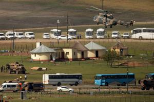 QUNU, SOUTH AFRICA - DECEMBER 15:  A South African Defense Forces helicopter arrives in the childhood village of former South African President Nelson Mandela during his state funeral December 15, 2013 in Qunu, South Africa. Mr. Mandela passed away on the evening of December 5, 2013 at his home in Houghton at the age of 95. Mandela became South Africa's first black president in 1994 after spending 27 years in jail for his activism against apartheid in a racially-divided South Africa.  (Photo by Chip Somodevilla/Getty Images)