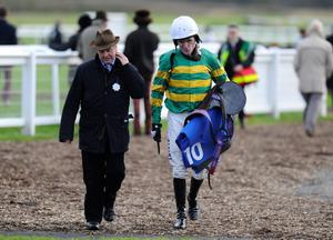 EXETER, ENGLAND - NOVEMBER 05: Jonjo O'Neill with Tony McCoy at Exeter racecourse on November 05, 2013 in Exeter, England. (Photo by Alan Crowhurst/Getty Images)