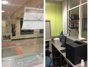 Police posted a picture of the damage caused to the windows of the health centre's reception in west Belfast.