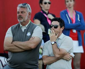 Europe captain Darren Clarke and Europe's Rory McIlroy watch on the 17th hole during a four-ball match at the Ryder Cup golf tournament Saturday, Oct. 1, 2016, at Hazeltine National Golf Club in Chaska, Minn. (AP Photo/David J. Phillip)