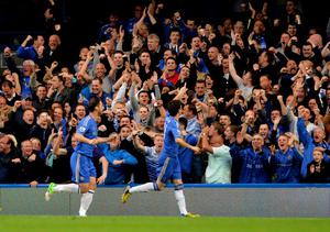 LONDON, ENGLAND - MAY 08:  Oscar #11 of Chelsea celebrates with the fans after scoring the opening goal during the Barclays Premier League match between Chelsea and Tottenham Hotspur at Stamford Bridge on May 8, 2013 in London, England.  (Photo by Shaun Botterill/Getty Images)