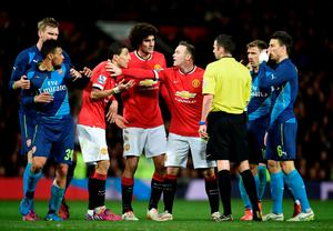 Flash point: referee Michael Oliver is surrounded before sending off Angel di Maria