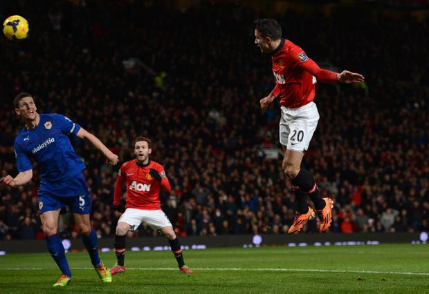 MANCHESTER, ENGLAND - JANUARY 28:  Robin van Persie of Manchester United scores the opening goal during the Barclays Premier League match between Manchester United and Cardiff City at Old Trafford on January 28, 2014 in Manchester, England.  (Photo by Michael Regan/Getty Images)