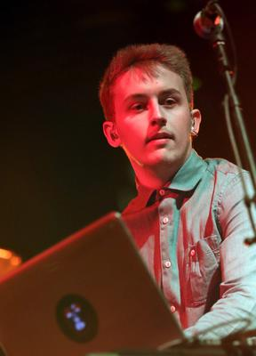 INDIO, CA - APRIL 14:  Musician Howard Lawrence of Disclosure performs onstage during day 3 of the 2013 Coachella Valley Music & Arts Festival at the Empire Polo Club on April 14, 2013 in Indio, California.  (Photo by Karl Walter/Getty Images for Coachella)