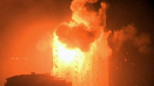 Explosion hits the media complex that houses the offices of Hamas-run Al Aqsa television and radio and a number of Arab satellite television news channels in central Gaza City early on Tuesday, July 29, 2014. (AP Photo/APTN)