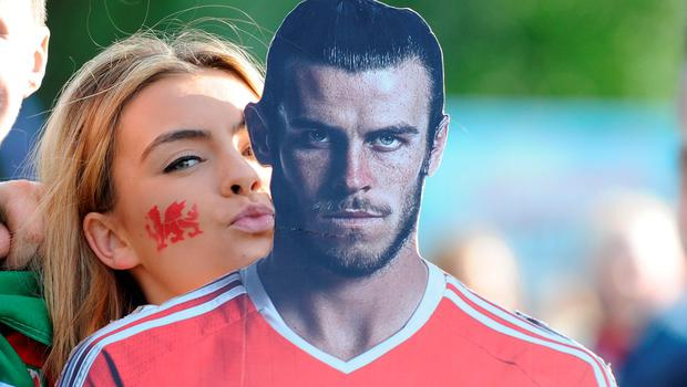 Wales fans ahead of watching the Wales v Belgium game at Coopers Field fanzone, Cardiff. PA