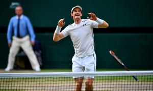 TOPSHOT - Britain's Andy Murray celebrates beating Canada's Milos Raonic during the men's singles final match on the last day of the 2016 Wimbledon Championships at The All England Lawn Tennis Club in Wimbledon, southwest London, on July 10, 2016. / AFP PHOTO / LEON NEAL / RESTRICTED TO EDITORIAL USELEON NEAL/AFP/Getty Images
