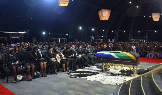 Family members and guests attend the funeral service for former South African President Nelson Mandela in a makeshift tent in Qunu, South Africa, Sunday, December 15, 2013. (AP Photo/Odd Andersen, Pool)