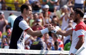 Andy Murray, of Great Britain, shakes hands with Juan Monaco, of Argentina, after their match at the 2016 Summer Olympics in Rio de Janeiro, Brazil, Tuesday, Aug. 9, 2016. Murray defeated Monaco 6-3, 5-1.(AP Photo/Charles Krupa)