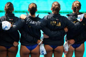 RIO DE JANEIRO, BRAZIL - AUGUST 09: The Italian Team line up for the national anthem ahead of the Water Polo Preliminary Round Group B match between Italy and Brazil on Day 4 of the Rio 2016 Olympic Games at the Maria Lenk Aquatics Centre on August 9, 2016 in Rio de Janeiro, Brazil.  (Photo by Laurence Griffiths/Getty Images)