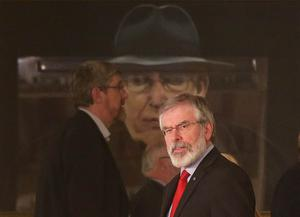 Northern Ireland parties return to Stormont after last eek's Assembly election.   Sinn Fein's president Gerry Adams pictured going past a portrait of the former First Minister and DUP leader Ian Paisley as he leads his party to talk to the media on the steps of Stormont's Parliament Buildings, east Belfast.   Photo by Jonathan Porter / Press Eye.