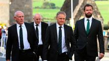 Michael Keaney, Keith Wood, Joe Schmidt and Andy Farrell arrive to view the coffin of Munster Rugby head coach Anthony Foley in repose in St. Flannan's Church, Killaloe in Co Clare, ahead off his funeral tomorrow. PA