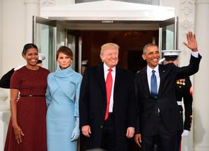 US President Barack Obama(R) and First Lady Michelle Obama(L) welcome Preisdent-elect Donald Trump(2nd-R) and his wife Melania to the White House in Washington, DC January 20, 2017.  AFP/Getty Images