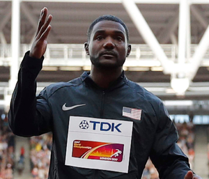 Unpopular winner: Justin Gatlin was booed when winning the World 100m final and collecting his gold medal from Lord Coe