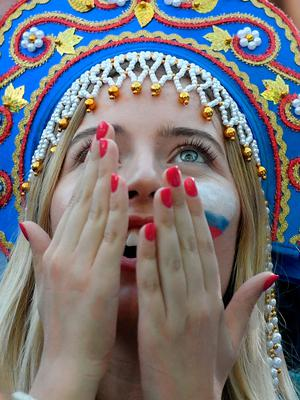 Russian fans watch the quarter-final football match between Russia and Croatia on a giant screen at the Fan Fest in Saint Petersburg on July 7, 2018 during the Russia 2018 football World Cup tournament. / AFP PHOTO / OLGA MALTSEVAOLGA MALTSEVA/AFP/Getty Images