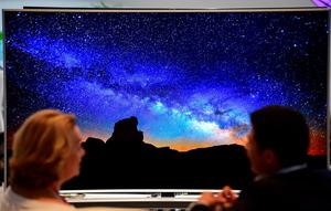 Visitors sit in front of a Samsung SUHD TV at the booth of South Korean electronics giant Samsung ahead of the opening of the 55th IFA (Internationale Funkausstellung) electronics trade fair in Berlin on September 3, 2015. IFA, Europe's largest consumer electronics and home appliances fair opens from September 4 to September 9, 2015. AFP PHOTO / JOHN MACDOUGALLJOHN MACDOUGALL/AFP/Getty Images