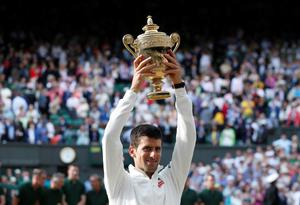 Serbia's Novak Djokovic celebrates defeating Switzerland's Roger Federer in the Mens' Singles Final during day fourteen of the Wimbledon Championships at the All England Lawn Tennis and Croquet Club, Wimbledon.