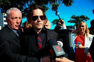 US actor Johnny Depp (2nd L) arrives at a court in the Gold Coast on April 18, 2016.  Depp and his wife Amber Heard arrived at an Australian court April 18 over Heard's alleged illegal importation of their two Yorkshire terrier dogs Boo and Pistol into the country in a private jet in 2015, as Depp was in Australia for the filming of the latest Pirates of the Carribean movie.    / AFP PHOTO / Patrick HAMILTONPATRICK HAMILTON/AFP/Getty Images