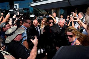 GOLD COAST, AUSTRALIA - APRIL 18:  Johnny Depp and Amber Heard leave Southport Magistrates Court on April 18, 2016 in Gold Coast, Australia. Heard is facing two counts of breaching Australia's quarantine laws by allegedly bringing in her pet dogs Pistol and Boo on a private jet in May 2015.  (Photo by Matt Roberts/Getty Images)