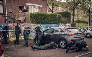 TSG carry out searches at the scene of a murder in the Lenadoon Avenue area of west Belfast on May 18th 2020 (Photo by Kevin Scott for Belfast Telegraph)