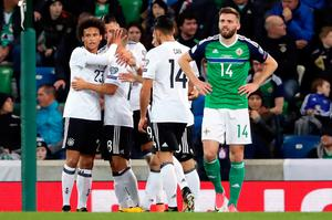 Germany's Joshua Kimmich celebrates scoring his side's third goal of the game with his team-mates during the 2018 FIFA World Cup Qualifying, Group C match at Windsor Park, Belfast. PRESS ASSOCIATION Photo. Picture date: Thursday October 5, 2017. See PA story SOCCER N Ireland.Niall Carson/PA Wire.