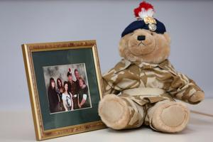 A teddy bear bought by murdered soldier Lee Rigby for his son, Jack, sits alongside a family photograph after a family statement was read out by his stepfather Ian Rigby, at  a press conference at the Regimental HQ of his unit, the Royal Regiment of Fusiliers at Bury in Greater Manchester